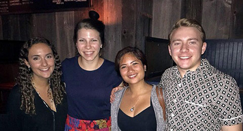 four interns smiling