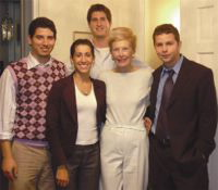 Betty Stickell stands with four young interns